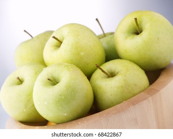 Wet Green Apples On A Bowl