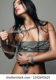 Wet Hair Beautiful young woman in steel chain. wet passion sexy girl with make-up
