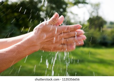 Wet hands and flying water drops.