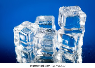 Wet ice cubes with water droplets