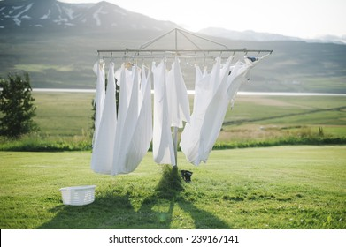 wet laundry  drying in the sun with the mountains on the background
