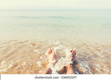wet male feet on the beach