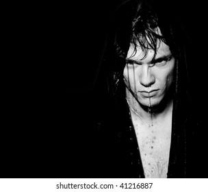 wet man on a dark background