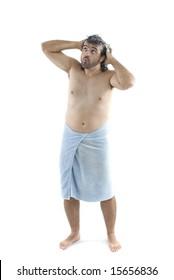 Wet Man using bath towel on white .