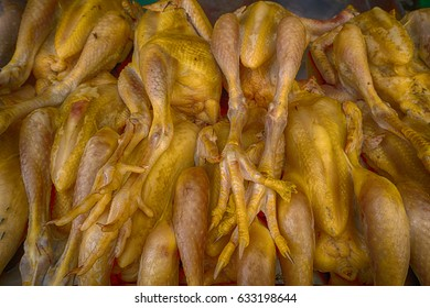 Wet market poultry game meat pork tripe along streets of Cambodia Siam Reap heritage village town