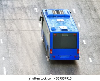 Wet multi lane wide street with modern public transportation system city blue bus aerial top down back view background