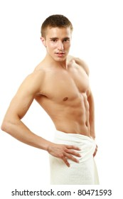 Wet muscular man wrapped a white towel isolated on white