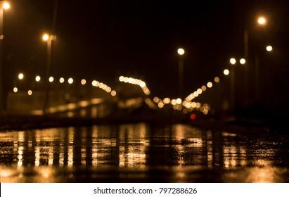 wet night asphalt with lights bokeh