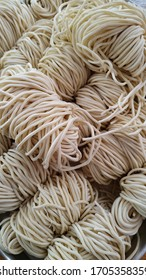 Wet noodles or raw noodle ingredients for making chicken noodles and dumpling noodles