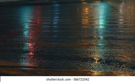 Wet old crosswalk in the night lighting