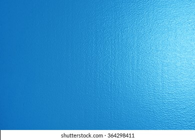 Wet painted wall new blue paint background texture
