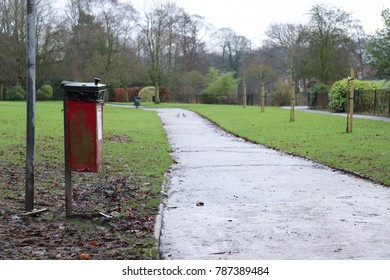 Wet Park Footpath with Red Bin