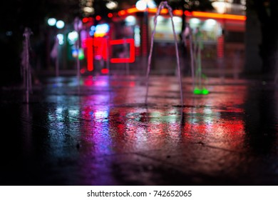 Wet pathway with defocused building behind abstract