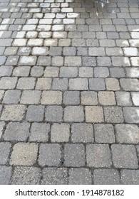 Wet paver tile driveway texture