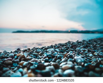 wet pebble stones and small waves at the beach