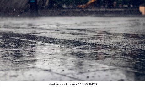 Wet rainy floor ground on a urban cityscape
