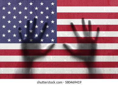 Wet rainy Usa flag with human hands. Conceptual ambition and faith background.