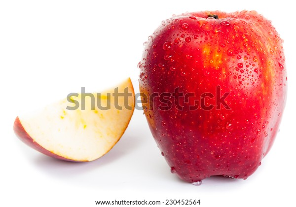 wet red apple and slice