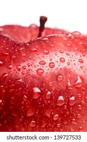 wet red delicious apple close-up