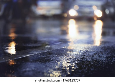 Wet road after hard rain fall at night  in the city.Selective focus and shallow depth of field composition.