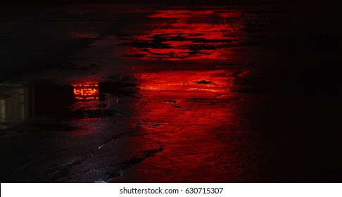 wet road asphalt reflections, red