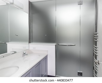 Wet room frosted glass walls and door installed in remodeled bathroom