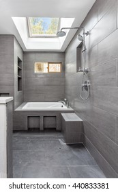 Wet room tile finished, with bathtub, shower and faucet installed