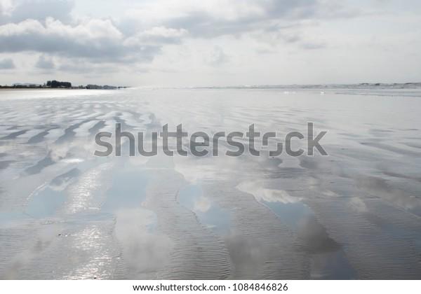 Wet sand on the beach