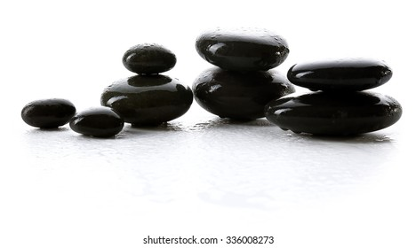 Wet spa stones isolated on white