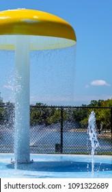 Wet splashpad on hot summer day