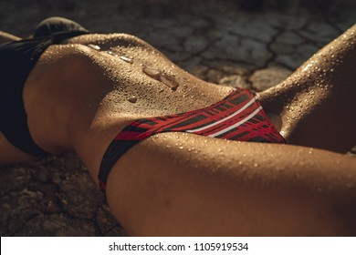 Wet stomach, ice with lingerie. Sexy female with. Rest on the beach