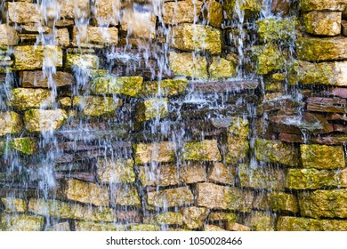 wet stone brick wall with water splashes for the abstract textured background