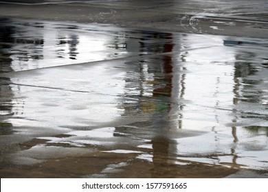 wet street in city after rain