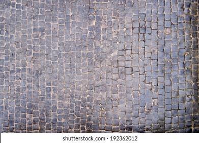 wet tiles, stone pavement