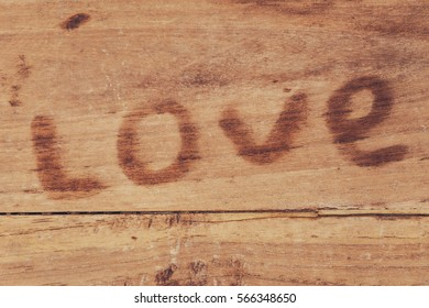 wet trail in the form of word of love on the old table, with space for text