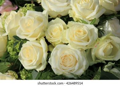 Wet white roses in a wedding arrangement