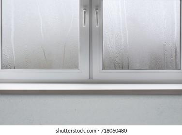 Wet window after autumn or winter rain