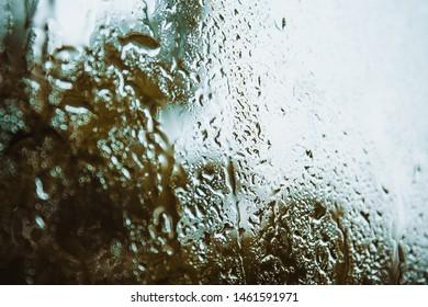 Wet window, autumn, rainy weather, cold, longing, sadness.