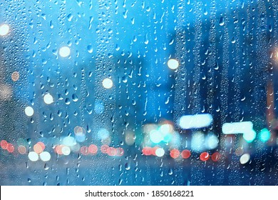 wet window city lights rain drops, abstract background autumn winter glow glass