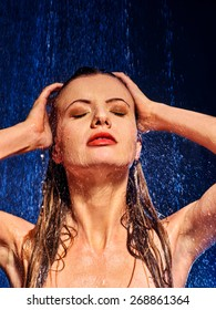 Wet woman face with water drop. Girl washes her head under shower