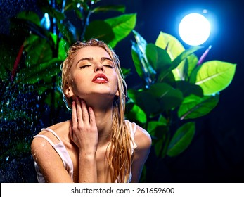 Wet woman in jungle with water drop. Nature.