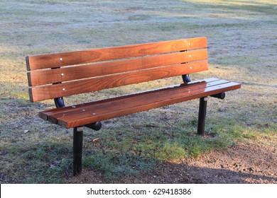 wet wooden park bench