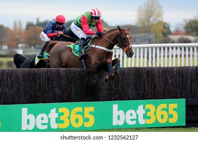 WETHERBY RACECOURSE, NTH YORKSHIRE, UK : 3 November 2018 : Definitly Red ridden by Danny Cook jumps the last fence before going on to win the Bet365 Charlie Hall Chase at Wetherby Races