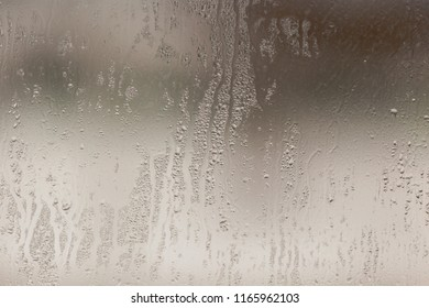 Wetted glass on the window as a background .