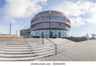 WETZLAR, GERMANY - APR 6, 2016: headquarters of famous camera manufactur Leitz in Wetzlar, Germany. The red spot symbolizes the world wide quality of Leica lenses and cameras.