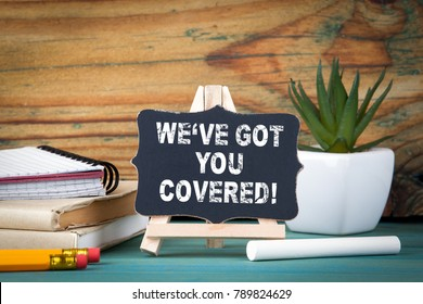 Weve got you covered. small wooden board with chalk on the table