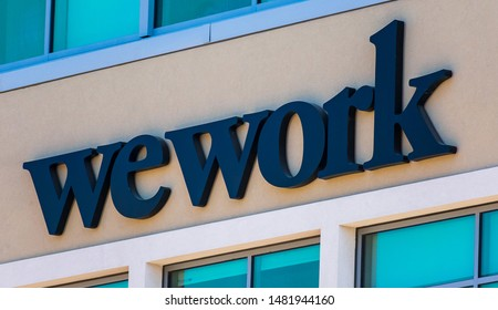 WeWork sign on office shared coworking space building located in Silicon Valley tech hub. The startup We Company is headquartered in New York City - San Mateo, California, USA - August 16, 2019