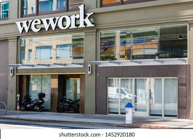 WeWork sign on shared coworking space at South of Market (or SoMa) neighborhood - San Francisco, California, USA - July 12, 2019