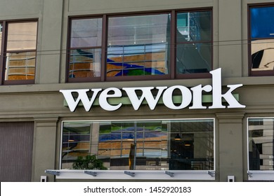 WeWork sign on shared coworking space of The We Company startup at South of Market (or SoMa) neighborhood - San Francisco, California, USA - July 12, 2019