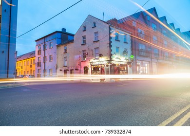WEXFORD, IRELAND - AUGUST 14; Street scene at night The John Barry Irish pub on corner long exposure with blurred and light trails effects, August 14, 2017 Wexford, Ireland